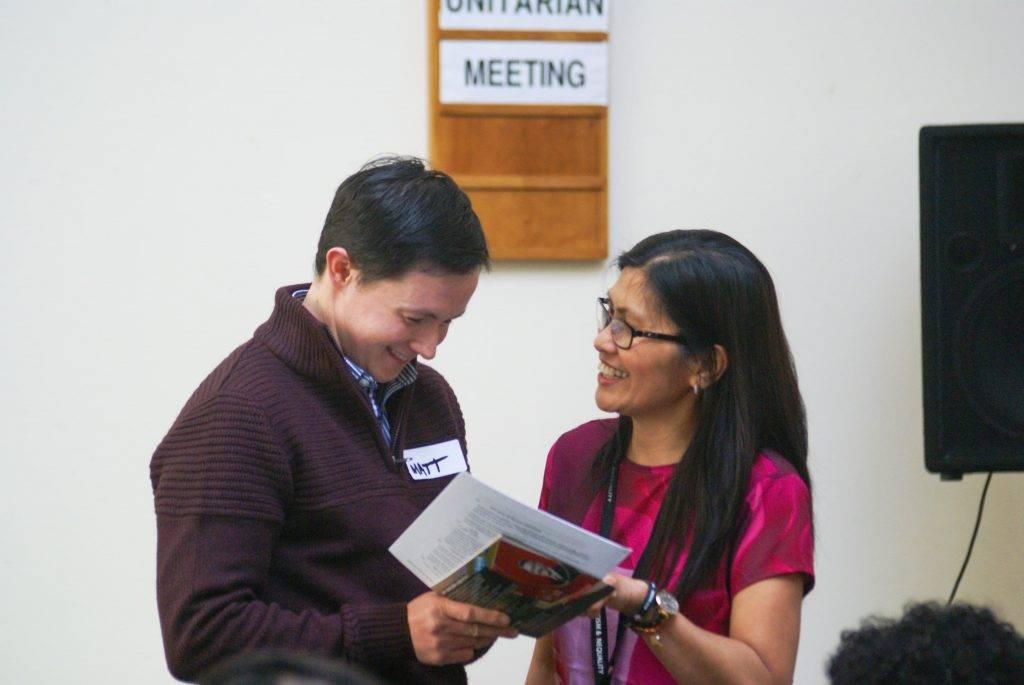 Volunteer and staff member smiling together