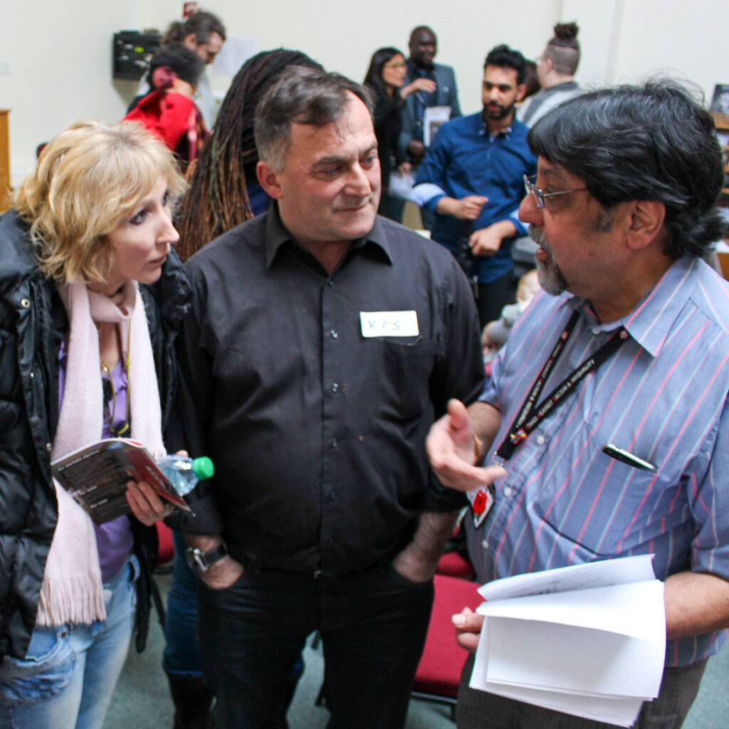 Caseworker talking with clients at event