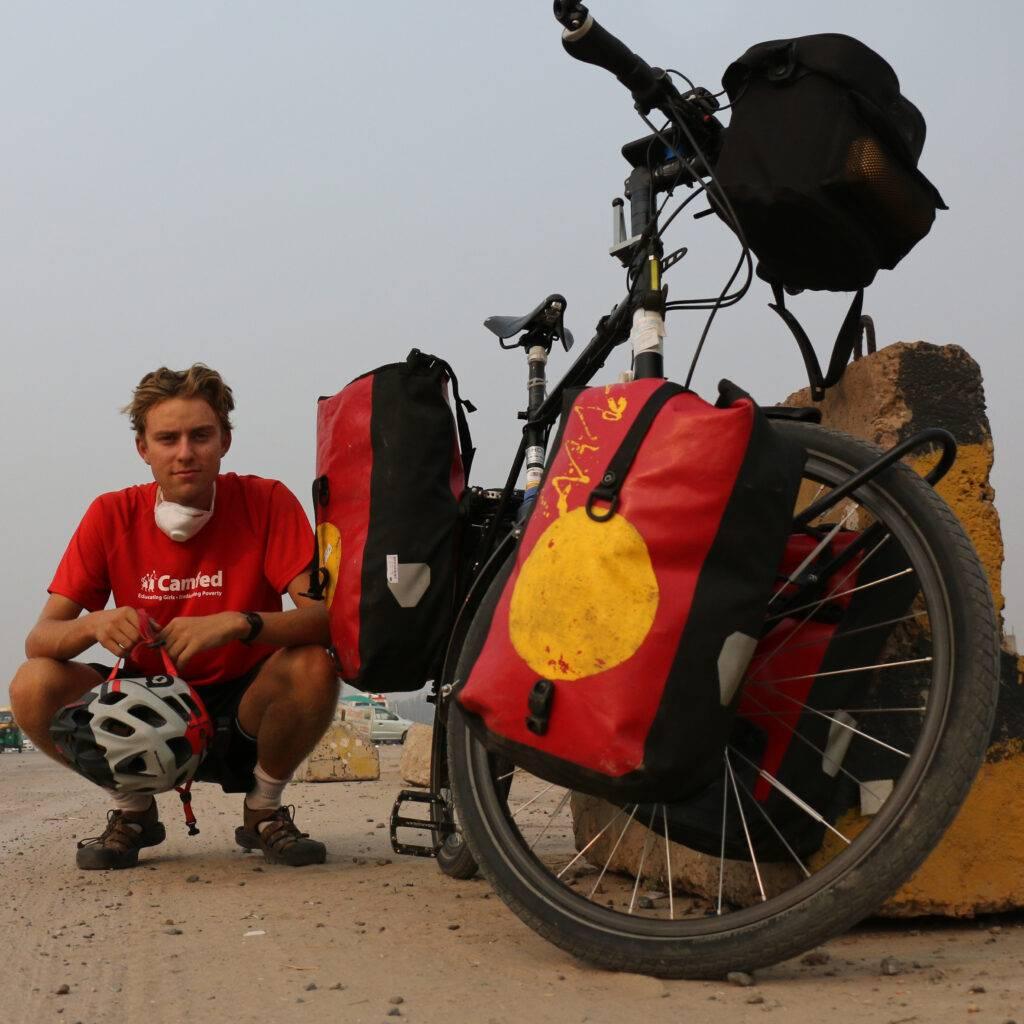 Ben knelt next to his bike